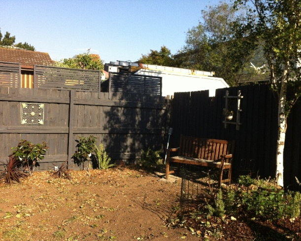 A very bare and brown looking garden